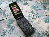 Mobile phone laying on banknotes of Russia