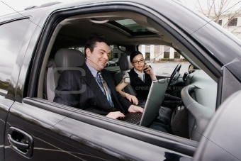 Businessman and Businesswoman in a Car