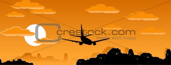 Aeroplane silhouette on the evening sky background