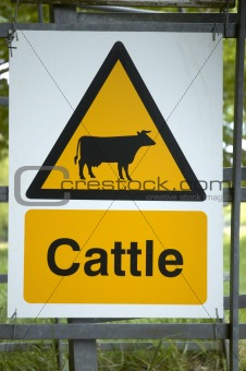 A cattle sign on a fence