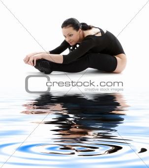 fitness in black leotard on white sand #2