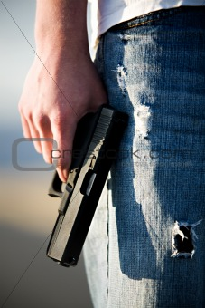 teen with handgun