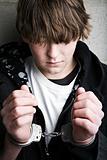 teen crime - kid in handcuffs