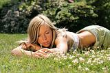 Girl lays in grass
