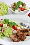 Pork steak with vegetable salad