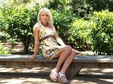 Young Blond teen in dress outdoors
