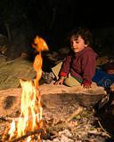 boy at campfire