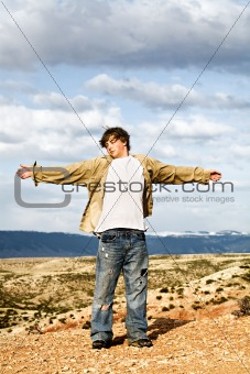 teen with arms wide open