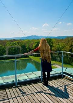 Blond girl looking into horizon