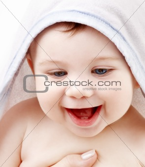 happy baby with terry hoodie robe on head
