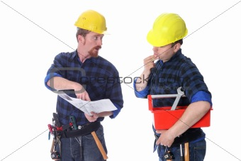 Two construction workers with architectural plans
