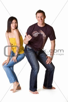 caucasian guy pointing to asian girl with him thumd