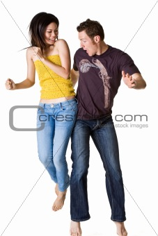 causasian guy and asian woman jumping excitedly