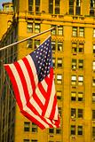 American flag and high rise building