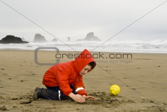 boy playing on beach, Oregon Coast