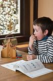 Boy doing homework at dinning table