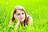 Young pensive on the grass