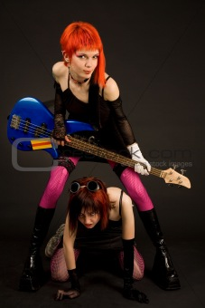 Two attractive girls with guitar