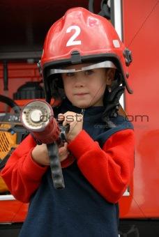 boy is sitting in a fire truck