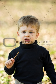 boy eating short stick