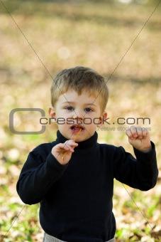 boy eating short stick
