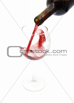 pouring red wine from a bottle