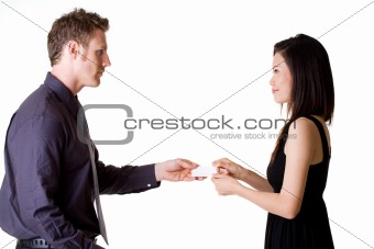 businessman exchanging name cards with woman