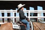 Young girl competing at horse show