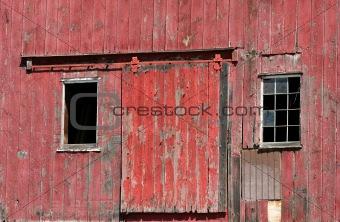 Old red barn door with windows