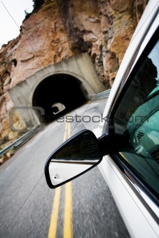 car approaching tunnel