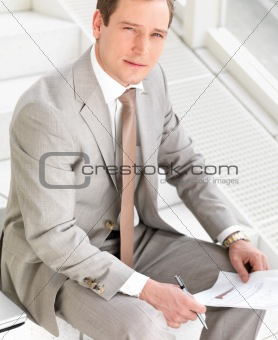 Young business man with paperwork