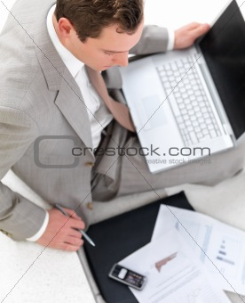 Handsome business man going over paper work