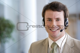 Business man wearing head set