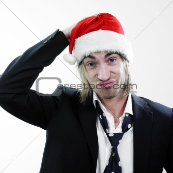 Skeptical man with christmas hat.