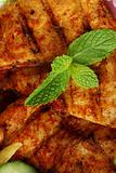 Middle eastern grilled hamour fish with mint leaves