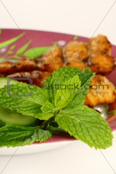close up of fresh green mint leaves on food