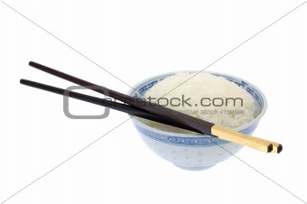 Bowl of cooked rice with chopsticks