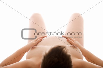 Pregnant naked woman lying on her back
