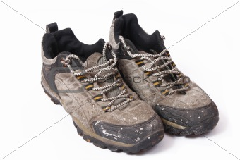 Old and dirty shoes isolated on white background