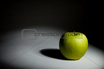 Green apple under the spot
