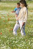 mother and son walking through flowers