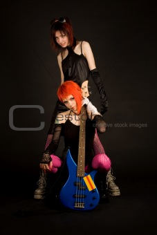 Two rock girls with guitar