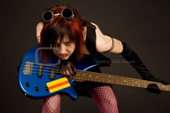 Sensual girl with bass guitar