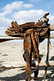 saddle on rural fence