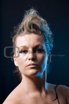 Strong, beautiful woman with extreme makeup