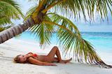 Cute girl On the beach. Luxury holidays!