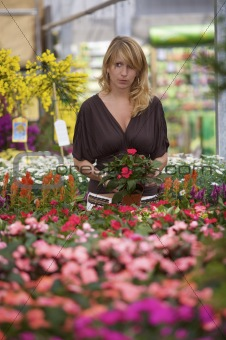 Beautiful blond in gardencenter