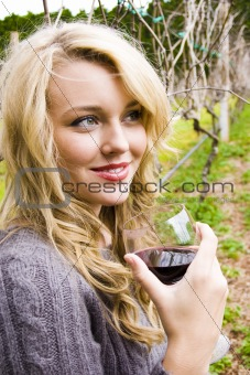Beautiful young woman in a vineyard