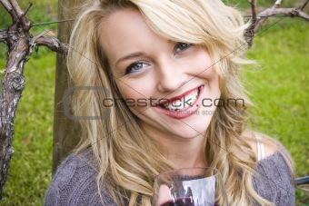 Beautiful young woman in a vineyard
