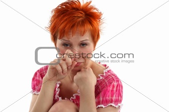 Crying young red haired woman isolaited on white background
